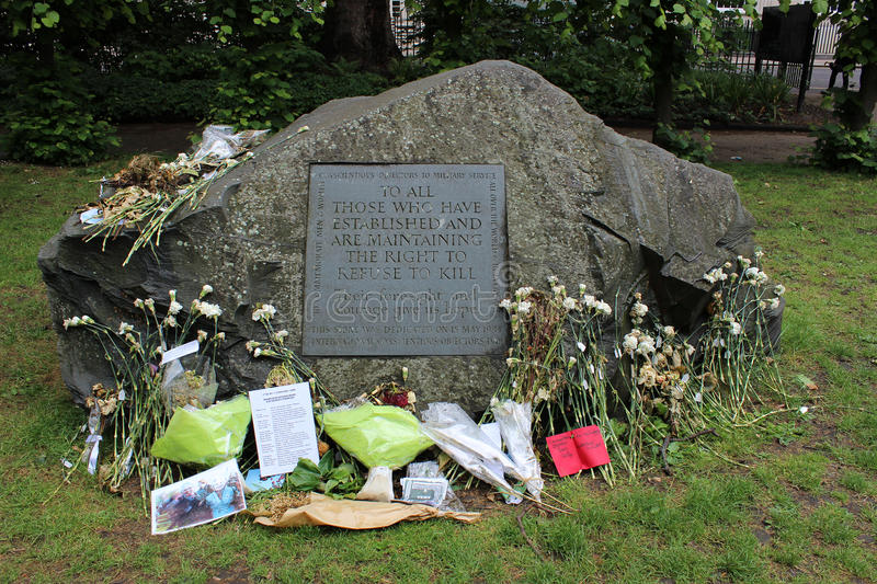 Memorial to Conscientious Objectors in Tavistock Square London. The Memorial to Conscientious Objectors with various tributes laid at the base of the stone royalty free stock image