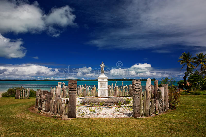Memorial to European Missionaries. A memorial to European Missionaries on Isle Of Pines, with carved totems stock photography