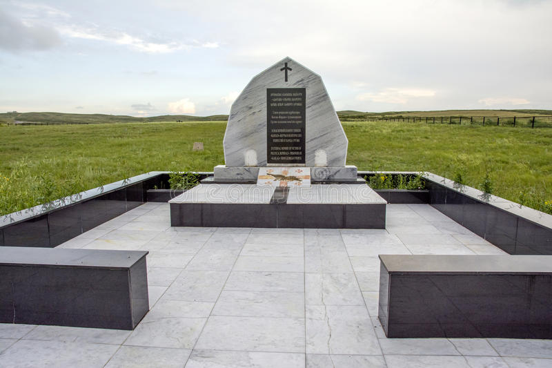 Memorial to prisoners of KarLang in Spassky. Monument from nation of Georgia. Spassky Memorial:After the Second World War Stalin`s Prison Camps were completely stock photo