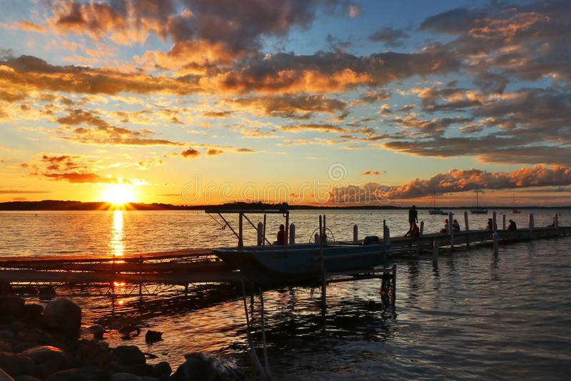 Sunset over the lake Mendota. Memorial Union shore with wooden piers is favorite place for enjoying golden hours in the city of Madison, the capital of royalty free stock images
