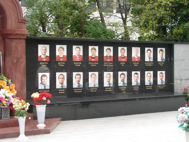 Memorial wall hockey `locomotive` in Yaroslavl. Cemetery in Yaroslavl Russia. Photos with the names of the dead hockey players. Flowers near the monument to stock images