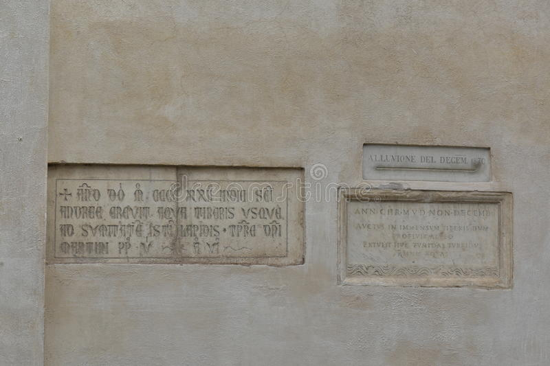 Memorials to the flooding of Tiber in Rome. Piazza della Minerva. Memorials to the flooding of the River Tiber between 1422 and 1598 on wall of church of Santa royalty free stock photos