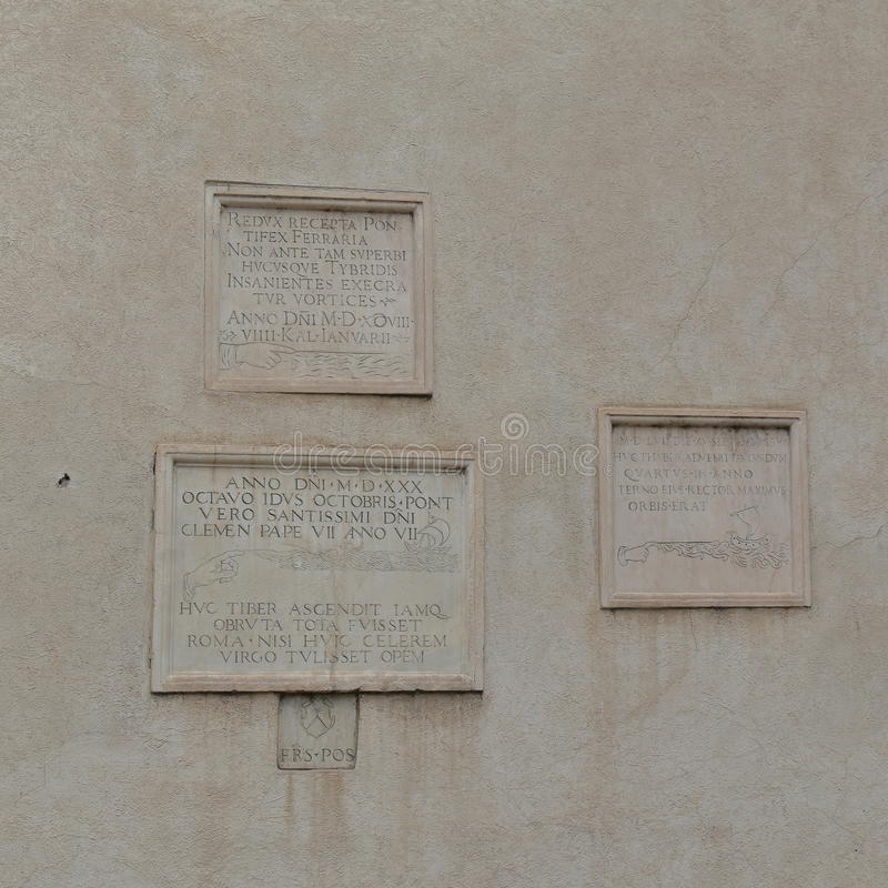 Memorials to the flooding of Tiber in Rome. Piazza della Minerva. Memorials to the flooding of the River Tiber between 1422 and 1598 on wall of church of Santa royalty free stock photography