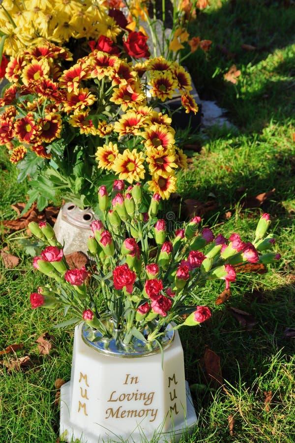Memoriam flowers standing up in vase royalty free stock photos