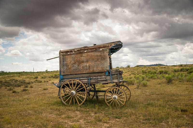Memories of the Old West. An old west sheriff's wagon sits on the lonesome frontier prarie as storm clouds gather in the distance royalty free stock images