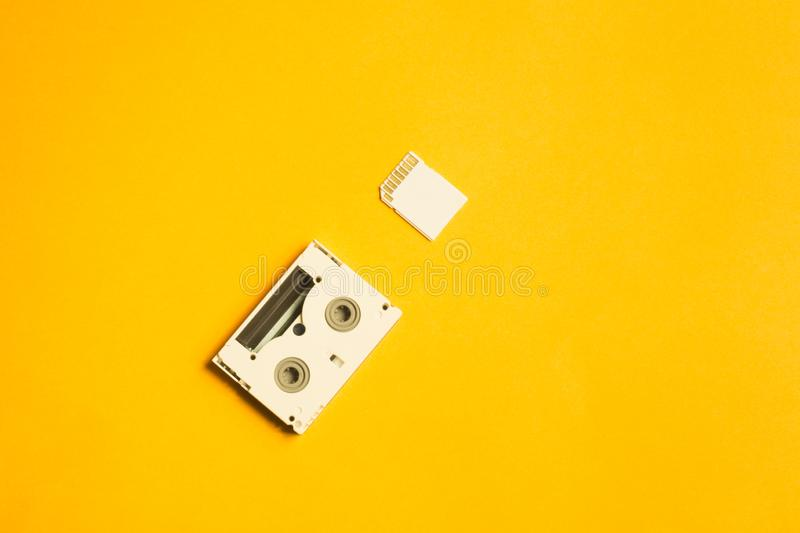 Memory card and digital video cassette on yellow background. copy space stock photo