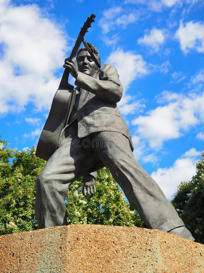 Elvis Presley Statue In Elvis Presley Plaza. MEMPHIS, TENNESEE - JULY 23, 2019: A bronze statue of Elvis Presley playing his guitar, erected by scuptor Andrea royalty free stock photos