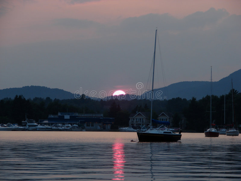 Download Memphremagog Lake At Sunset Stock Photo - Image of boat, calm: 5838138