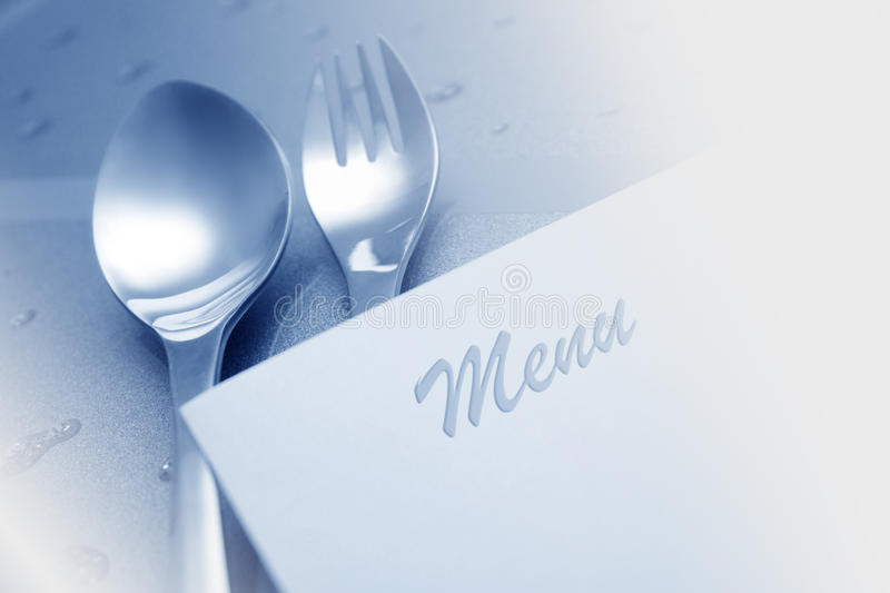 Menú con la cuchara y la fork foto de archivo libre de regalías