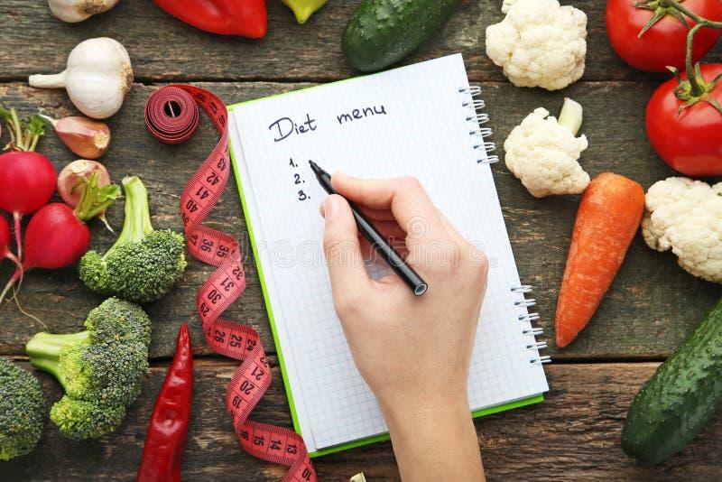Menú escrito mano de la dieta imagenes de archivo