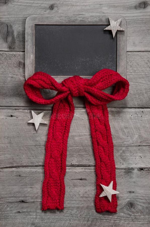 Menübrett oder -kupon für Weihnachten mit rotem Band für einen Hintergrund lizenzfreies stockbild