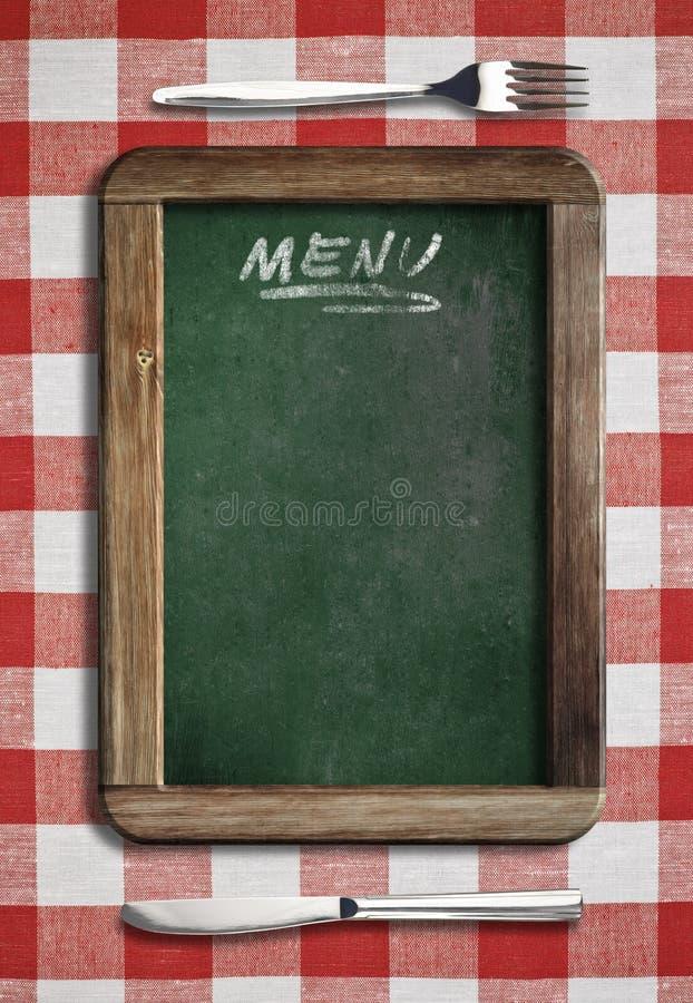 Menütafel auf Tabelle mit Messer und Gabel lizenzfreies stockfoto