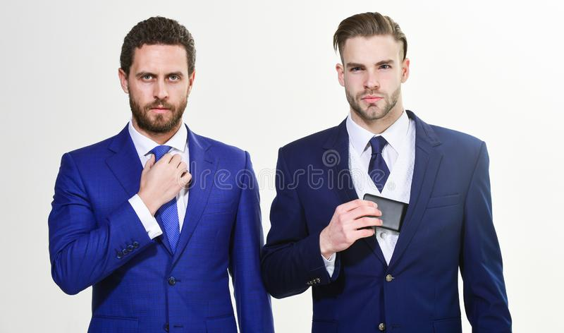 Men adjusting business suits. Confident in their style. Business people choose formal clothing. Every detail matters stock photo