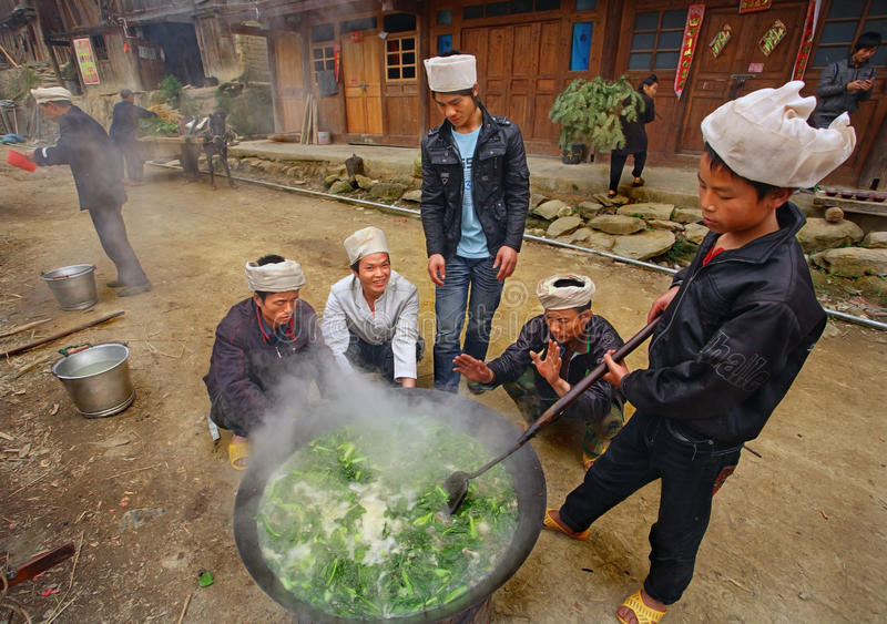 Men Asians, Chinese peasants, farmers, cook on rural street vil stock images