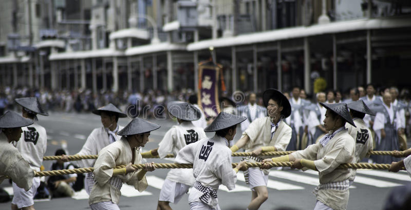 Men attempting to move Float of Gion Matsuri stock image