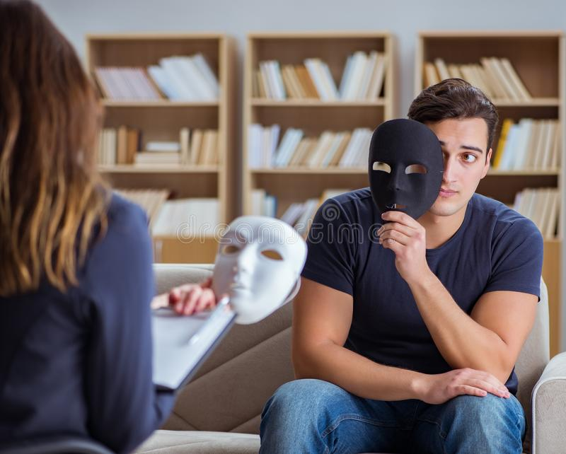 Man attending psychology therapy session with doctor stock image