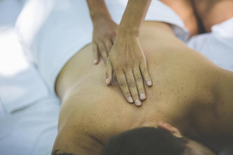Men at back massage. Close up. Above view royalty free stock photography
