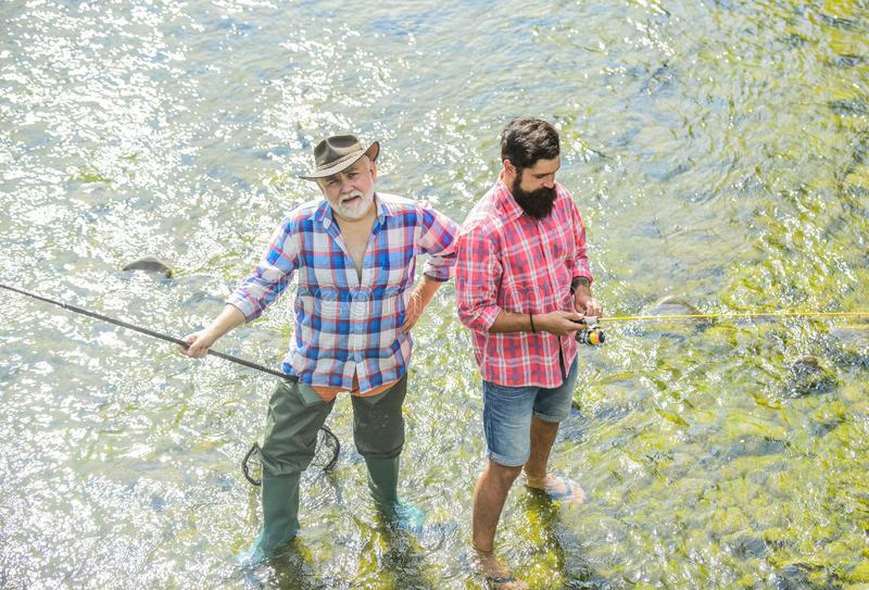 Men bearded fishermen. Weekends made for fishing. Active sunny day. Fishermen fishing equipment. Hobby sport activity stock photos