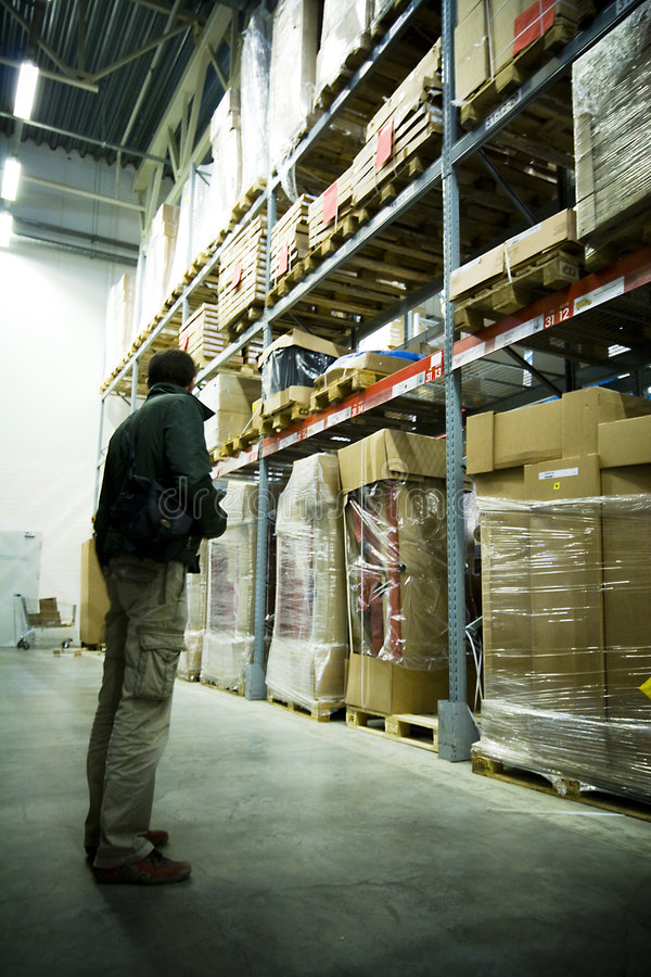 Men in big warehouse. Photo stock photography