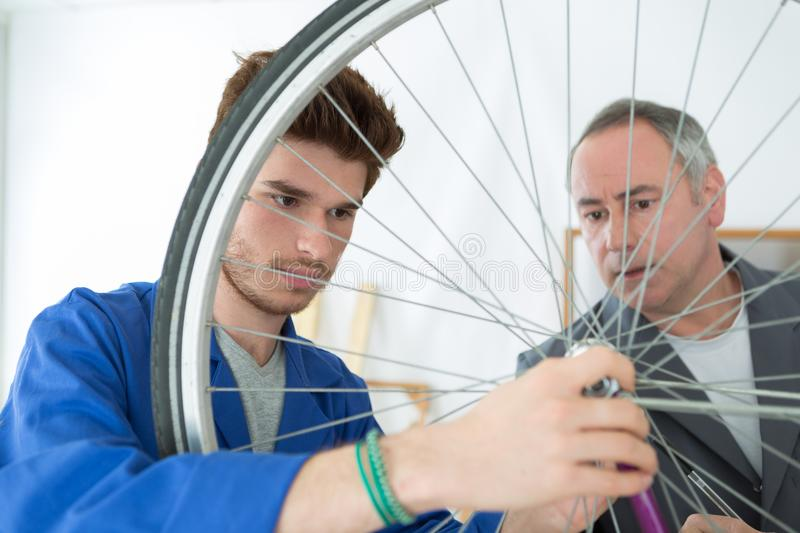 Men and bike tire. Men and the bike tire royalty free stock photography