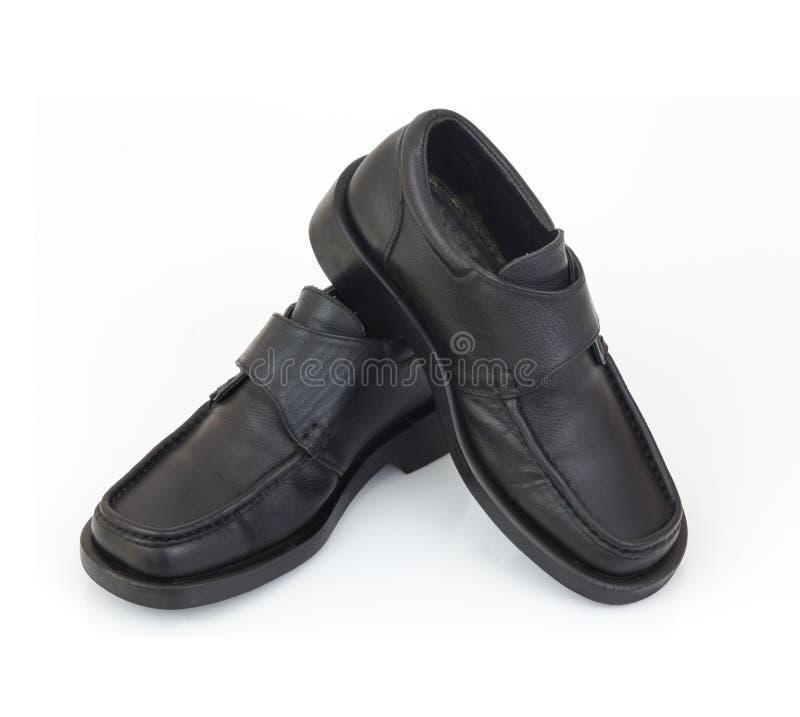 Men black shoes isolated on white background. Men black shoes isolated and white background royalty free stock photo
