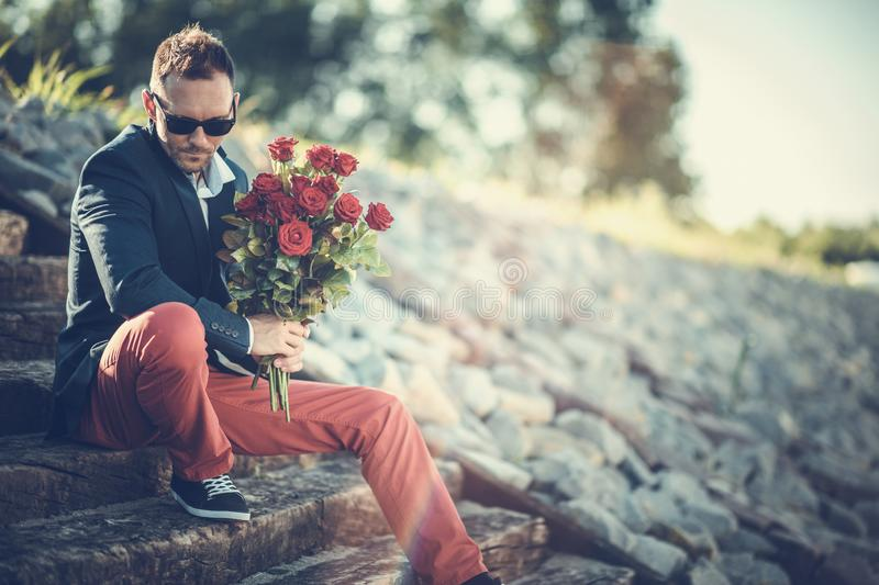Men with Bouquet of Roses royalty free stock photos