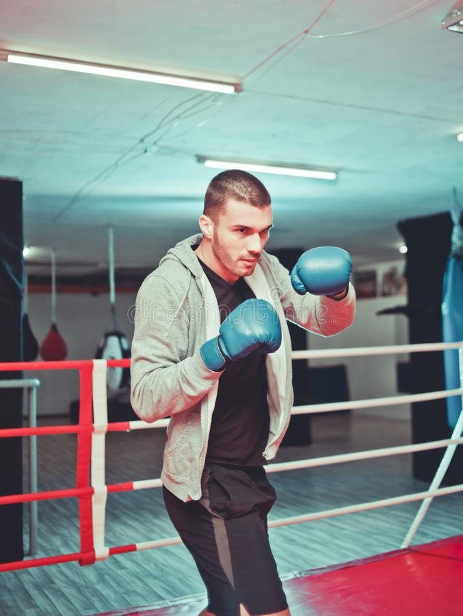 Men boxer doing shadow boxing. Inside boxing ring at gym. Boxer practicing his punches at a boxing studio stock photography