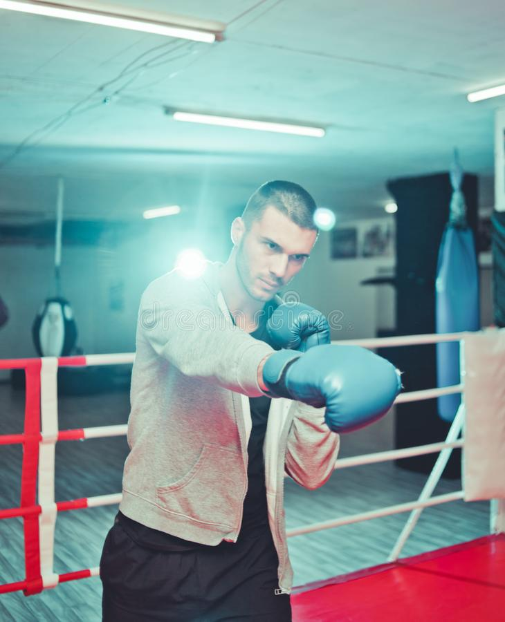 Men boxer doing shadow boxing. Inside boxing ring at gym. Boxer practicing his punches at a boxing studio royalty free stock image
