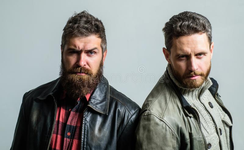 Men brutal bearded hipster. Handsome stylish and cool. Masculine and brutal friends. Bully team. Masculinity and royalty free stock photo