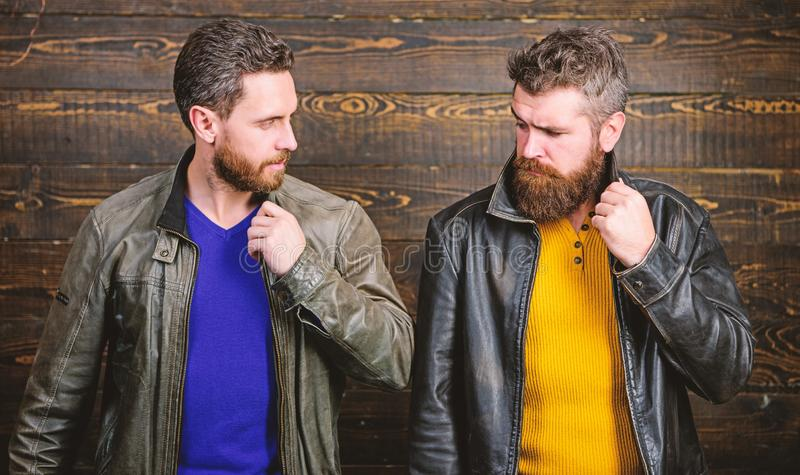 Men brutal bearded hipster posing in fashionable black leather jackets. Handsome stylish and cool. Feel confident in royalty free stock photography