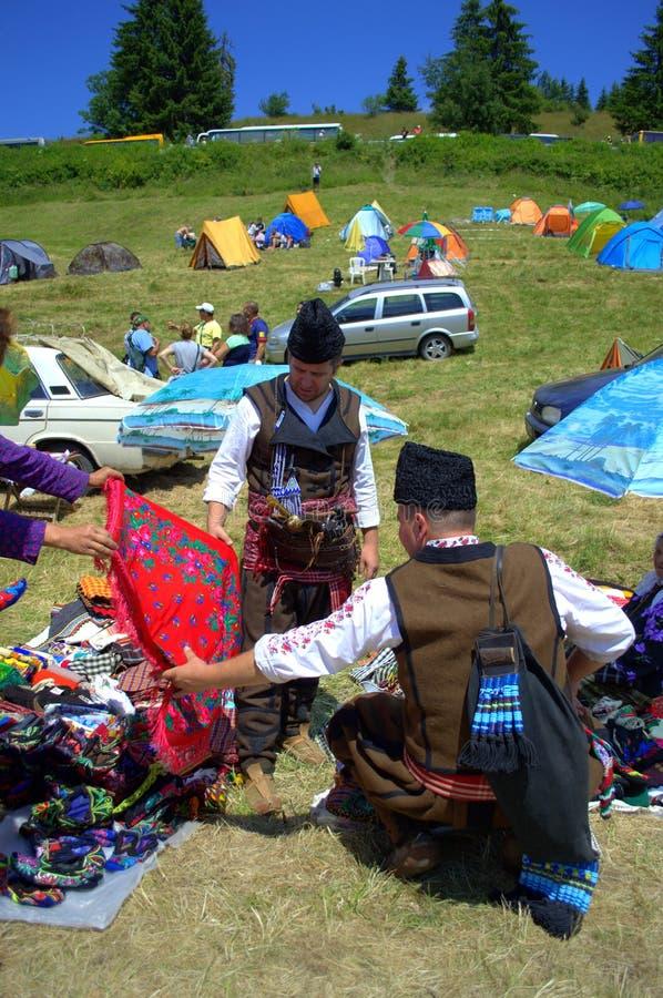 Men in bulgarian folk costumes shopping stock image