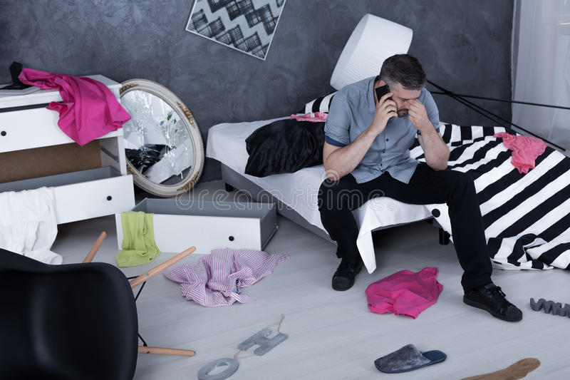 Men calling from messy room royalty free stock image