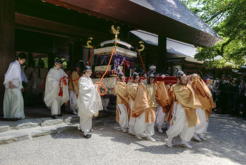 Men carrying an altar in Atsuta Shrine, Nagoya, Japan. Group of men carries an altar with phoenix during the Shinyotogyo Shinto ritual, which is a traditional royalty free stock images