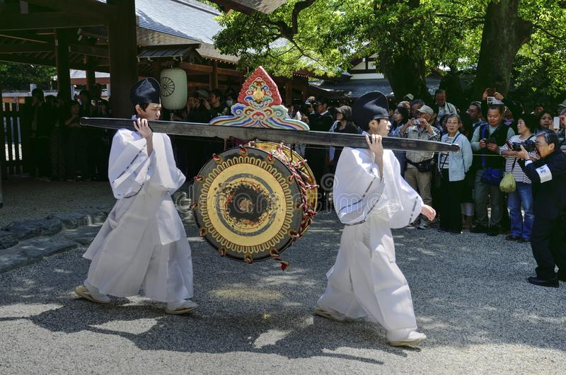 Men carrying a drum in Atsuta Shrine, Nagoya, Japan. Two men carries a drum during the Shinyotogyo Shinto ritual, which is a traditional Japanese ceremony in royalty free stock photography
