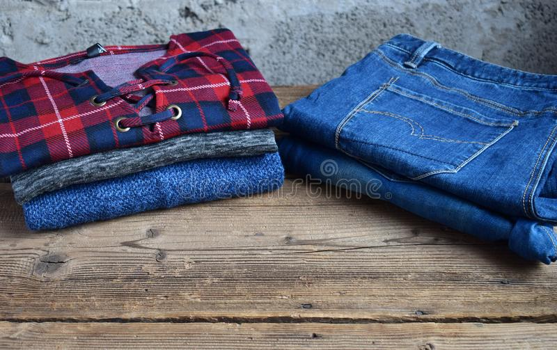 Men casual outfit. Men's shoes, clothing and accessories on wooden background - sweater, jeans. Top view. Flat lay. Men casual outfit. The Men's shoes royalty free stock photo