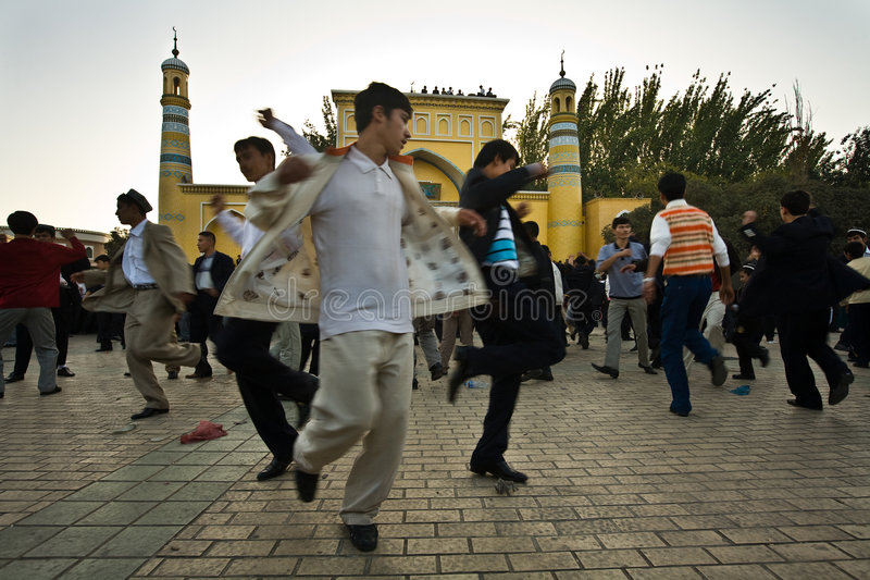 Men celebrate end of Ramadan by dancing royalty free stock photography