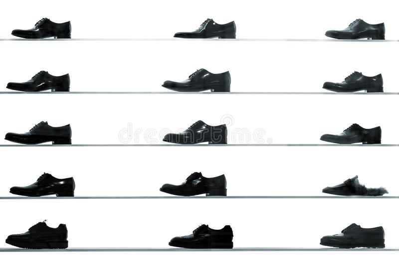 Men classic shoes displayed on shop shelves royalty free stock photography