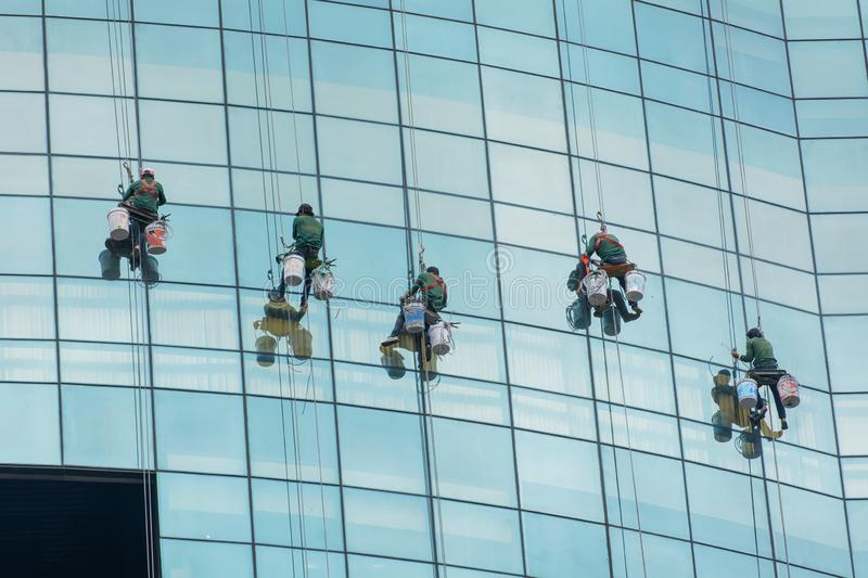 Men are cleaning the glass skyscrapers royalty free stock images