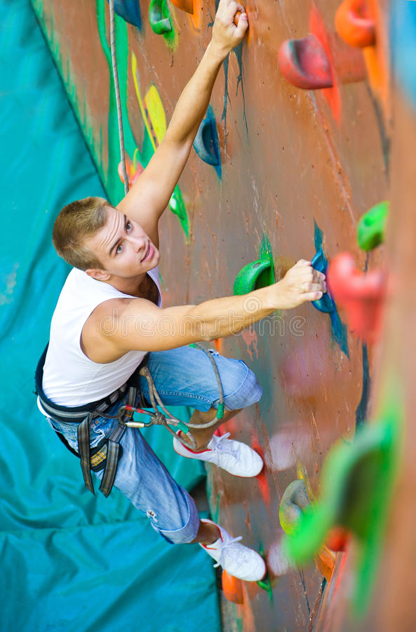 Men climbing on a wall royalty free stock image