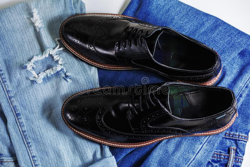 Men clothing with blue jeans and shoes. Men clothing with blue jeans and leather shoes stock images