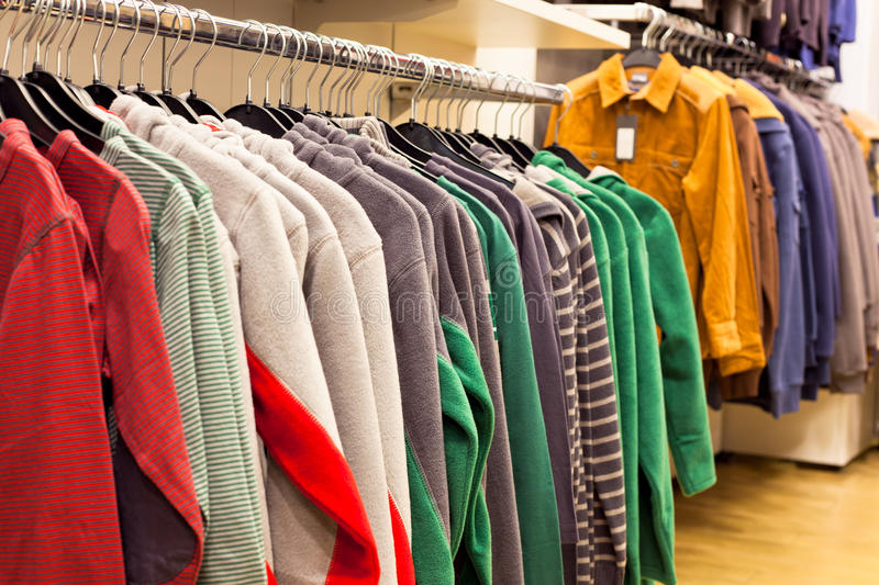 Men Clothing in Fashion Store royalty free stock photos