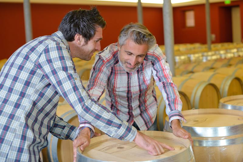 Men in the cooperage. Barrel royalty free stock images