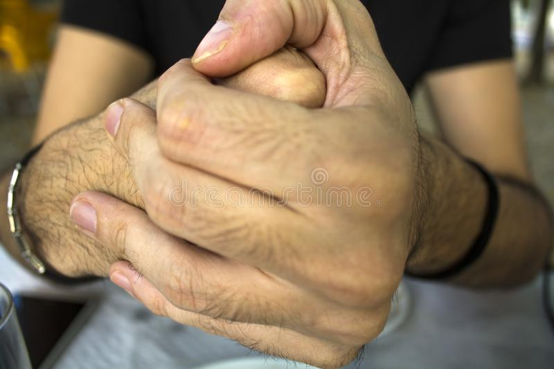 Men cracking their knuckles royalty free stock images