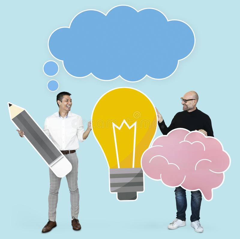 Men with creative ideas showing light bulb and brain icons stock photo