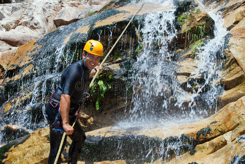Men descending waterfall royalty free stock images