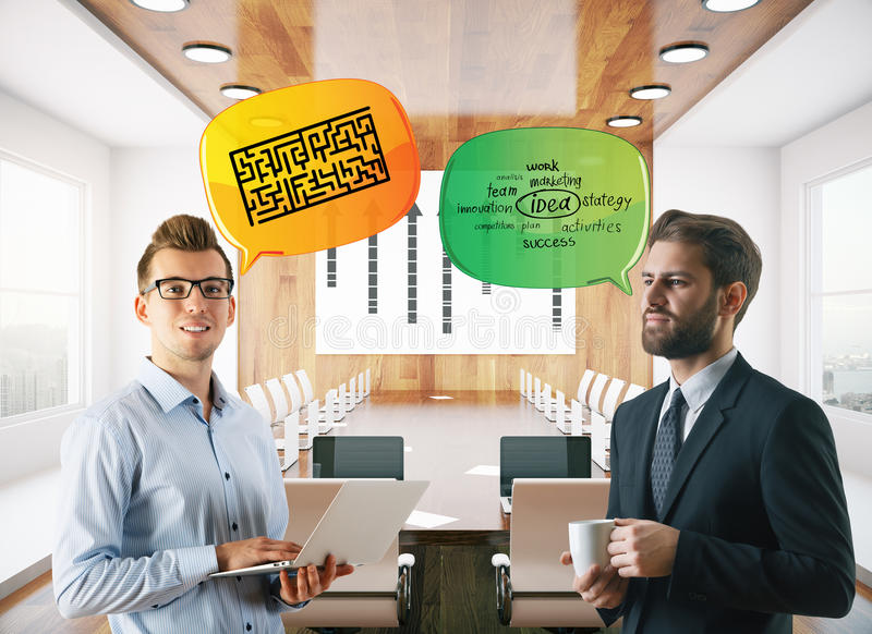 Men discussing business challenges and ideas royalty free stock photography