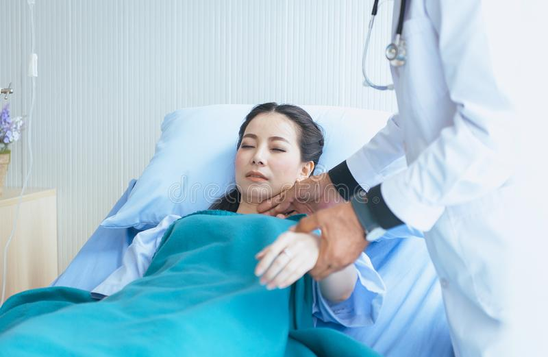 Man doctor examining asian woman patient and follow up treatment at hospital. Men doctor examining asian female patient and follow up treatment at hospital stock photography
