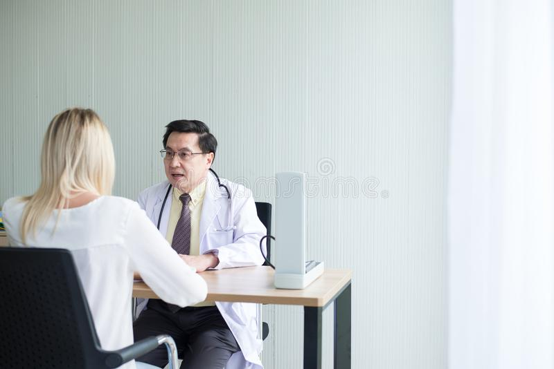 Man doctor examining to woman patient,Infertility counseling and suggestion at hospital stock images