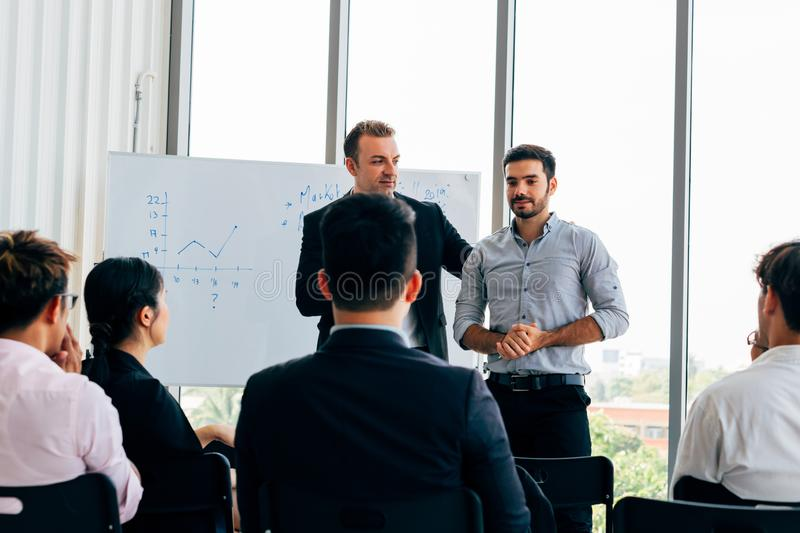 Men doing presentation in front of colleagues royalty free stock photos
