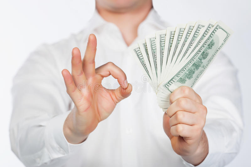 Men with dollars in hand royalty free stock photos